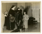 Photograph of Sister M. Stephanie, S.B.S. with Unidentified Students