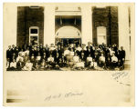 Group Photo with Booker T. Washington in Front of The Carnegie Library at Tuskegee Institute