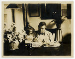 Booker T. Washington Working at His Desk.